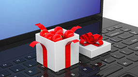 Open gift box full of Christmas balls on laptop Stock Images