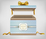 Open gift box . Gold bow. Blue color.label  text. Stock Image