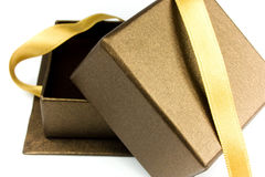 Open gift box with gold ribbon Royalty Free Stock Photos