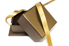 Open gift box with gold ribbon Stock Image