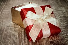Open gift box with golden bow Stock Photography