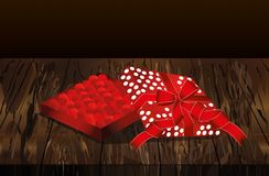 Open gift box with hearts inside. Valentine`s Day. Greeting card. Vector illustration isolate on wooden background Royalty Free Stock Image