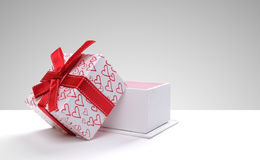 Open gift box with hearts printed with grey background front Royalty Free Stock Images