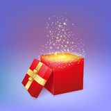 Open gift box with magic light fireworks. Royalty Free Stock Image