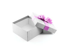 open and empty white gift box with purple ribbon bow isolated on white background Stock Photos