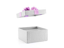 open and empty white gift box with purple ribbon bow isolated on white background Stock Photo