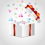 Open gift box with red bow Stock Photos