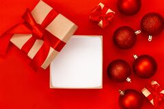 Free Open Gift Box, Red Christmas Balls On A Red Background With Copy Space.Christmas Composition. Flat Lay, Top View. Minimalistic Stock Photo - 202546590