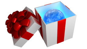 Open gift box with red ribbon and bow. And terrestrial sphere inside isolated on white Stock Photography