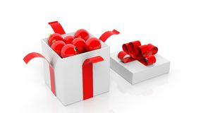 Open gift box with red ribbon full of Christmas balls. On white Royalty Free Stock Photos