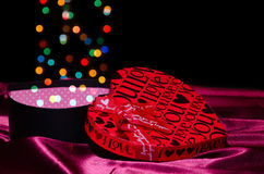 Open gift box shaped heart with Bokeh.  Stock Photography