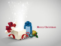 Open gift box with sparkling lights. On grey Royalty Free Stock Photography