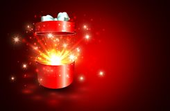 Open gift box with surprise and magic light fireworks.  Stock Images