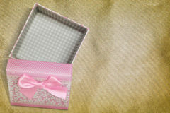Open gift box on vintage background Royalty Free Stock Images