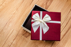 Open gift box on wood, surprise Royalty Free Stock Image