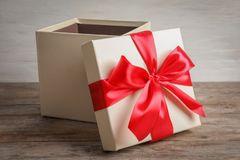 Open gift box on table. Open gift box on wooden table stock image