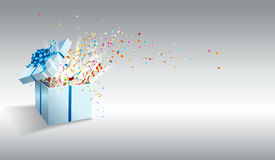 Open gift with fireworks from confetti. Royalty Free Stock Image
