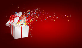 Open gift with fireworks from confetti. Stock Image