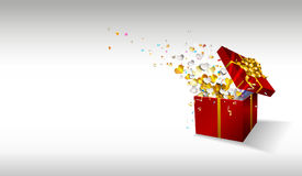 Open gift with fireworks from confetti and hearts on white background. Royalty Free Stock Photography