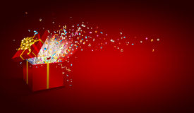 Open gift with fireworks from confetti on wooden background. . Congratulations on holiday. Border design. Background for promotions and offers.  Vector Royalty Free Stock Photo