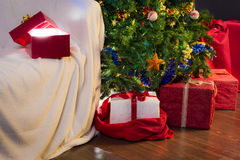 Open gift with light on christmas tree and gifts royalty free stock photo