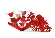Open gift red box with departing hearts with wings. Valentine`s Stock Photo
