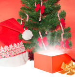 Open Gift under christmas tree Royalty Free Stock Images