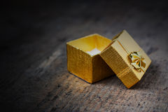 Open gift on a wooden surface Stock Photography