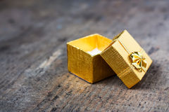 Open gift on a wooden table Stock Photo