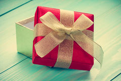 Open giftbox on blue wooden background Stock Image