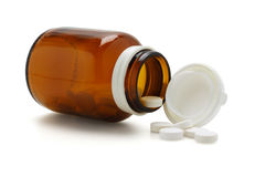 Open glass bottle and spliied tablets Royalty Free Stock Photography