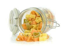 An open glass jar of pasta Stock Photography