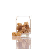 Open glass pot with brown cane sugar Royalty Free Stock Image