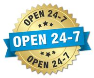 Open 24 7. Gold badge with blue ribbon Royalty Free Stock Photography