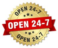Open 24 7. Gold badge with red ribbon Stock Image