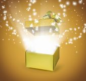 Open gold gift box with light effect. Open gold gift box floating glitter lid and light effect pop up from inside Stock Photos