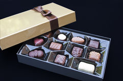 Open golden chocolate box. With a brown ribbon Stock Image