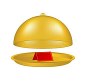 Open golden cloche with blank paper card Stock Images