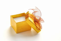 Open golden gift box with brown tie Stock Photography