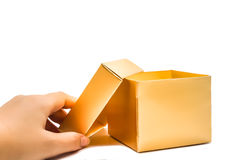 Open golden gift box hand hold. On white backbround Royalty Free Stock Image