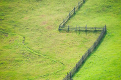 Open grass fields. Separated by a fence Stock Photography
