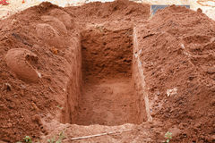 Open grave. Freshly dug for a burial Stock Photography