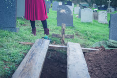 Open grave with woman Royalty Free Stock Photography