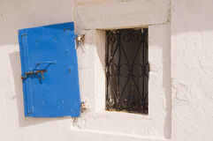 Open Greek window and blue shutter Royalty Free Stock Images