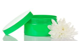 Open green jar with face cream and flower Stock Photos