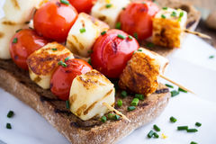 Open grilled  haloumi kebab sandwich with tomato Royalty Free Stock Photo