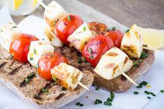 Open grilled  haloumi kebab sandwich with tomato Royalty Free Stock Photos