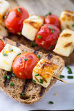 Open grilled  haloumi kebab sandwich with tomato Royalty Free Stock Photography