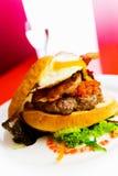 Open hamburger op een witte plaat Stock Foto's