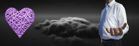 Open hand and heart by clouds. Digital composite of open hand and heart by clouds Royalty Free Stock Images